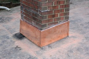 Rubber roof in Lexington, MA - copper chimney flashing