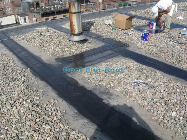 """Rubber roof repair in Boston, MA - complete reseam using 9"""" EPDM peal+stick cover tape"""